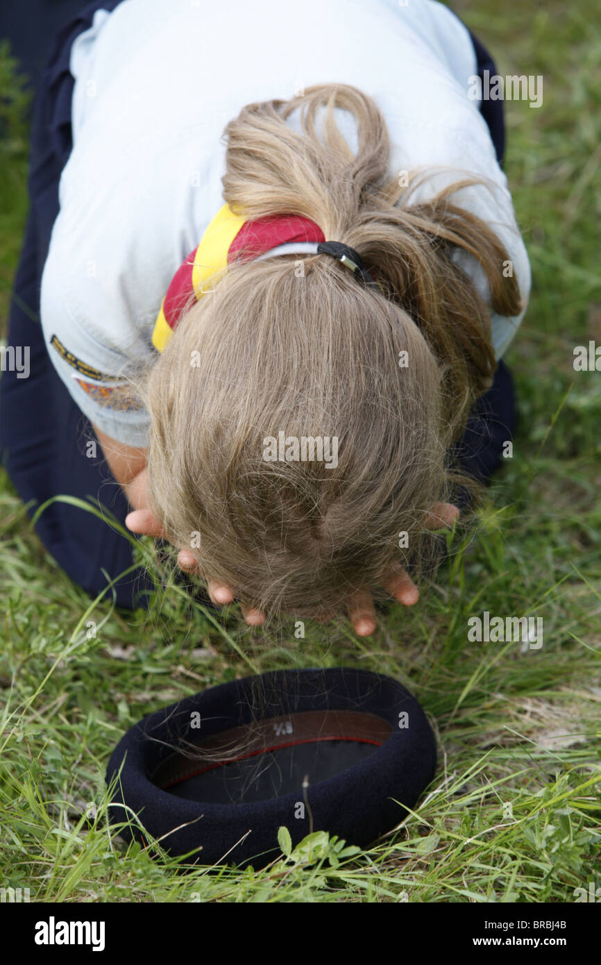 Girl Scout praying, traditionalist Catholic pilgrimage, Gas, Eure-et-Loir, France - Stock Image