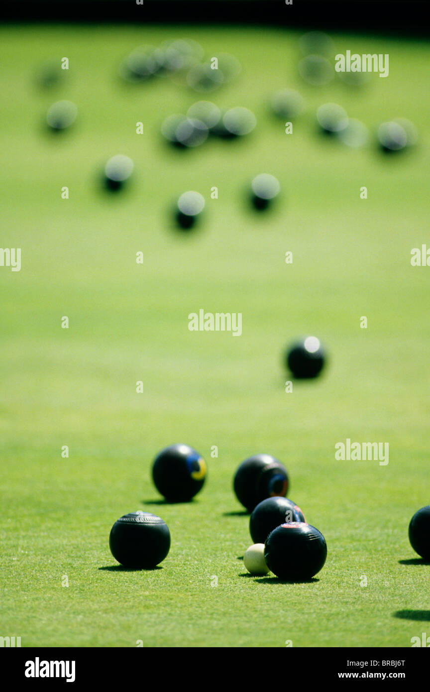 Sets of bowls on lawn bowls court - Stock Image