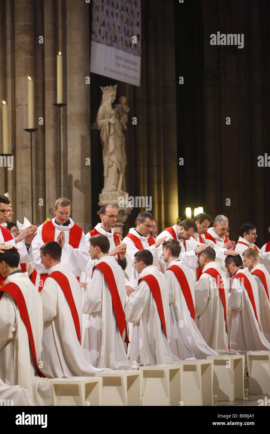 Priest ordinations at Notre Dame de Paris Cathedral, Paris, France - Stock Image