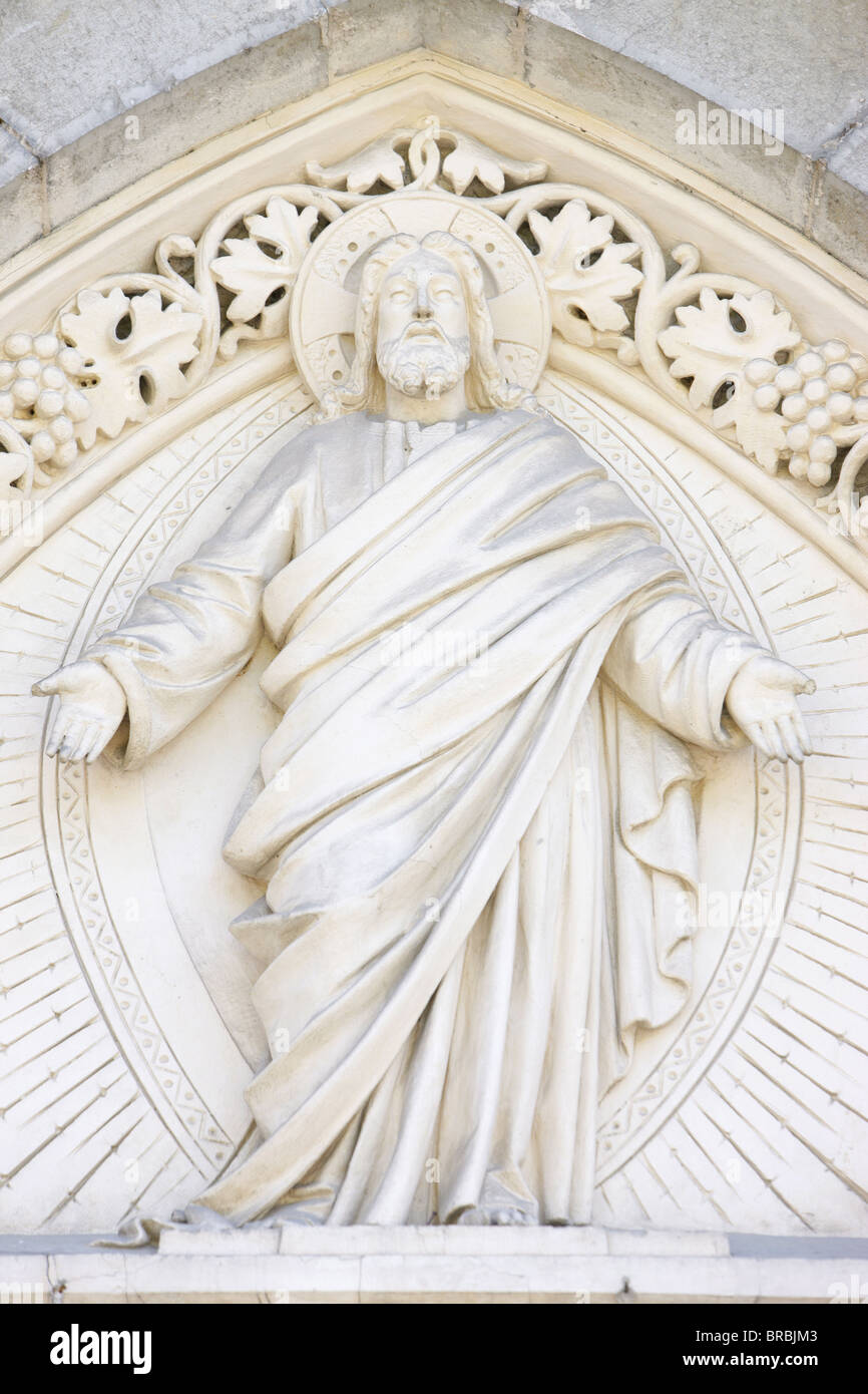 Christ sculpture on church tympanum, Le Moutaret, Isere, France - Stock Image