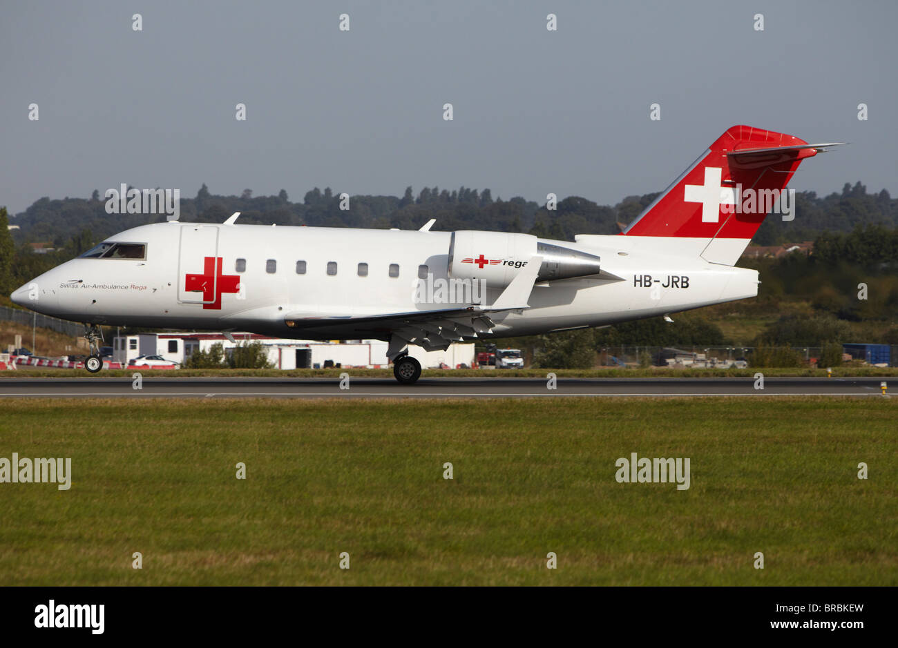 Rega Swiss Air Ambulance Bombardier CL-600 Challenger 604 landing at Luton Airport, Bedfordshire, England, United - Stock Image