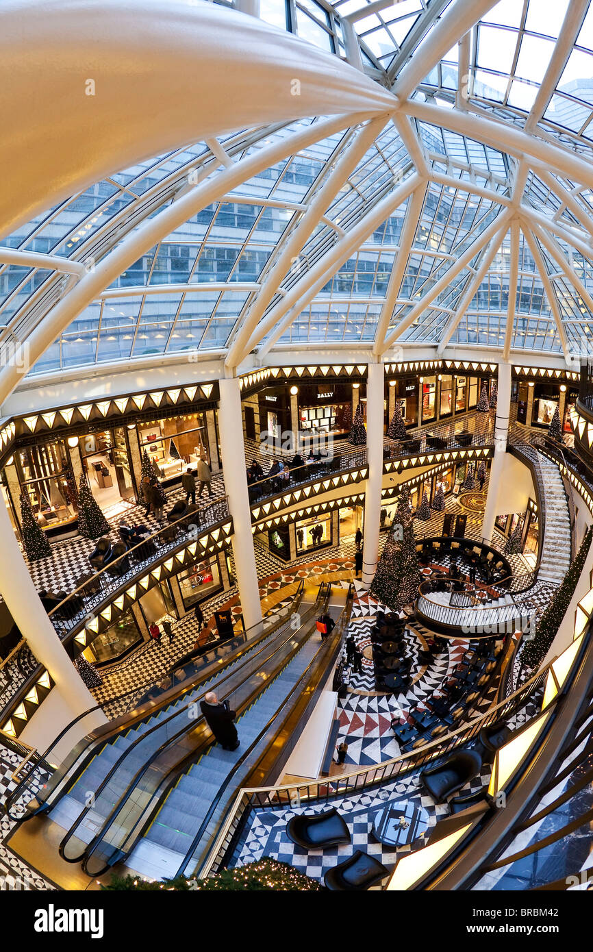 Spiral staircase and decorative floor tiles in luxury shopping centre, Quartier 206 on Friedrichstrasse, Berlin, - Stock Image