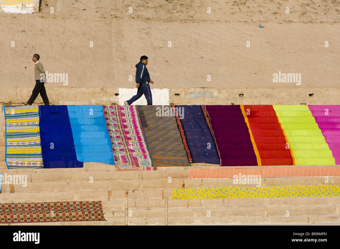 Saris drying on the ghats of Varanasi, Uttar Pradesh, India - Stock Image