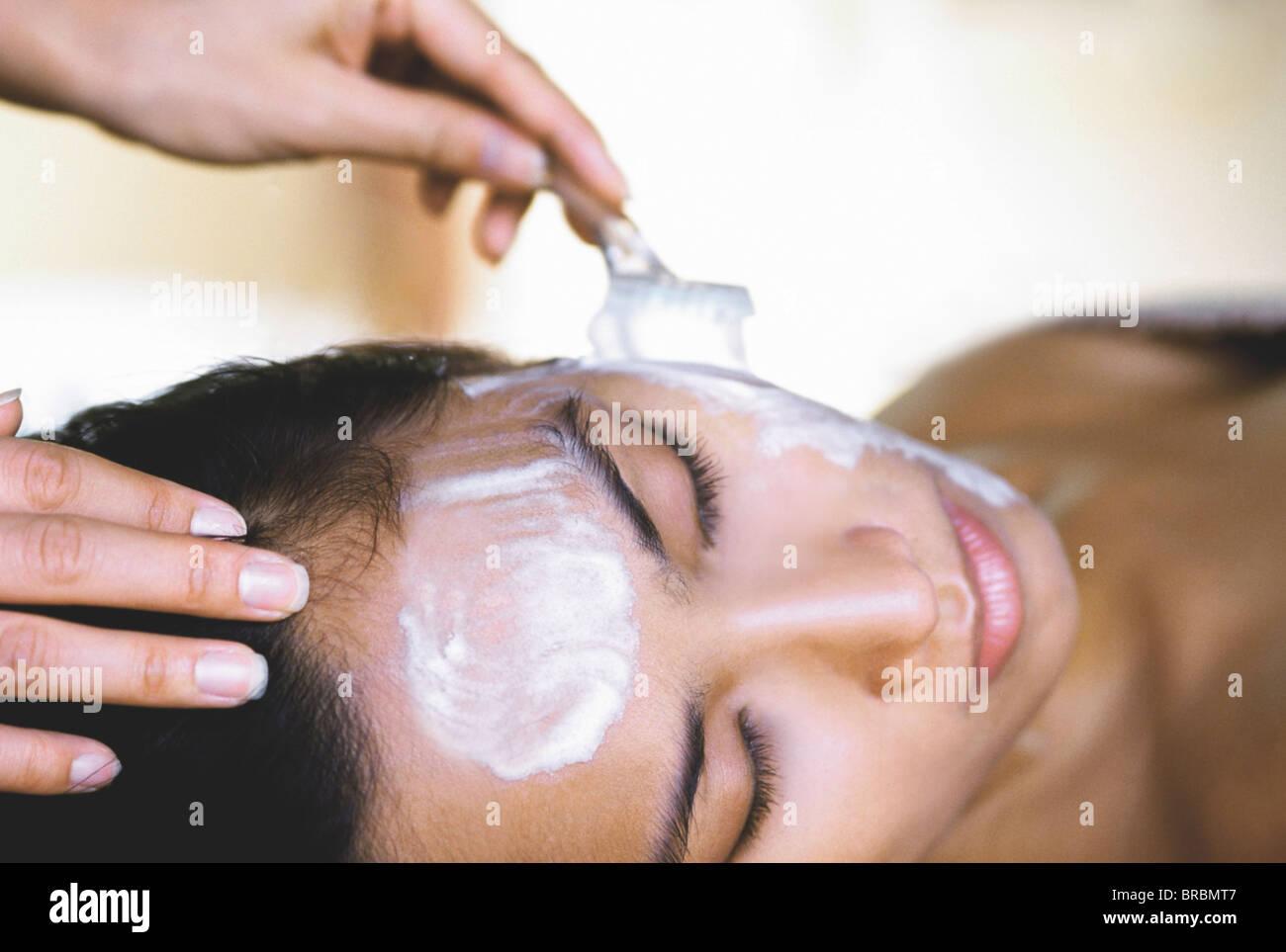 Woman having a facial, Kirana Spa, Indonesia - Stock Image