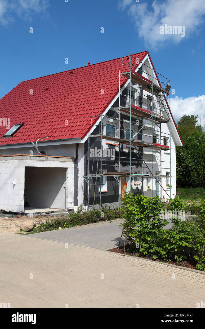 Shell construction of a typical new residential building with scaffolding. - Stock Image