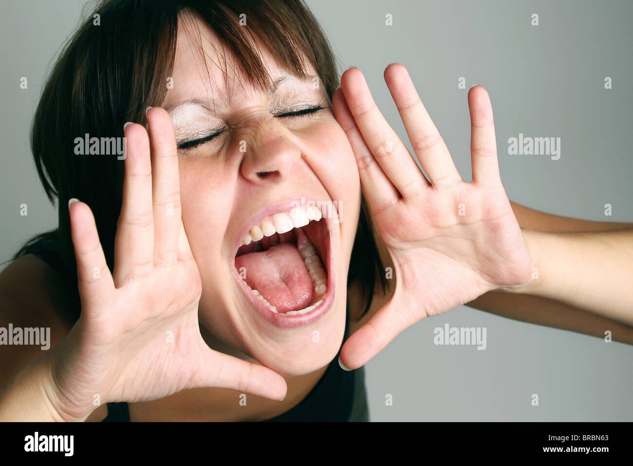 A screaming woman - Stock Image