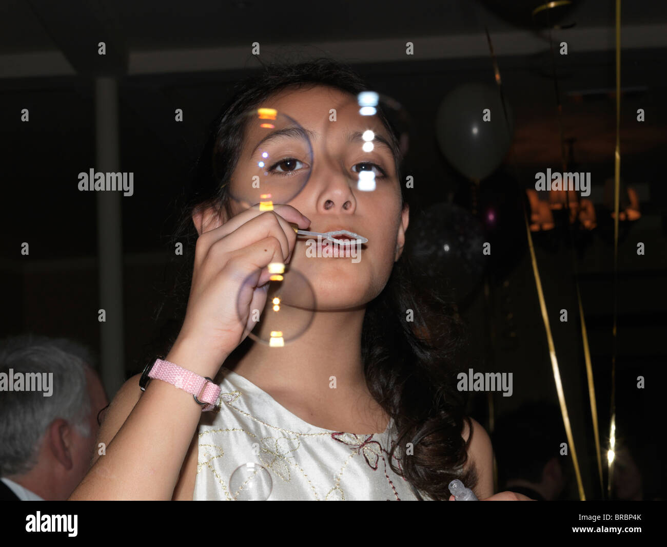 12 Year Old Girl Blowing Bubbles At A Wedding Stock Photo 31606307
