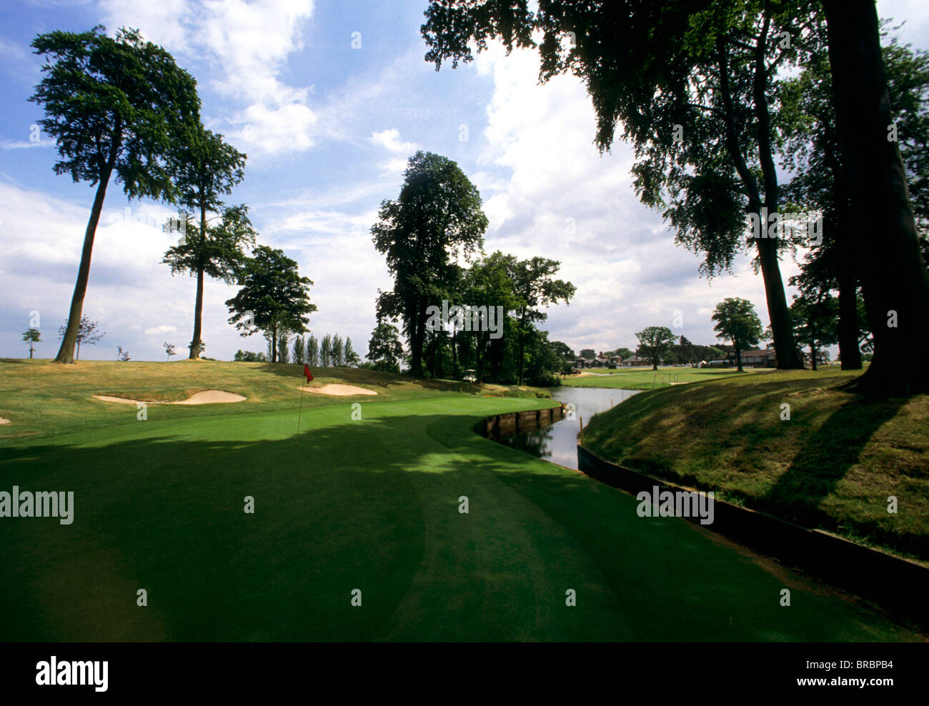 View of a golf green across brook - Stock Image