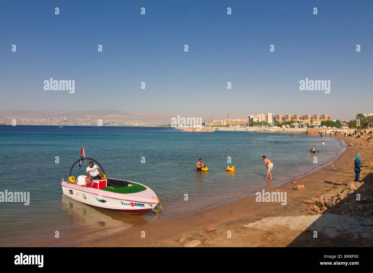 Public beach in Aqaba, Jordan - Stock Image