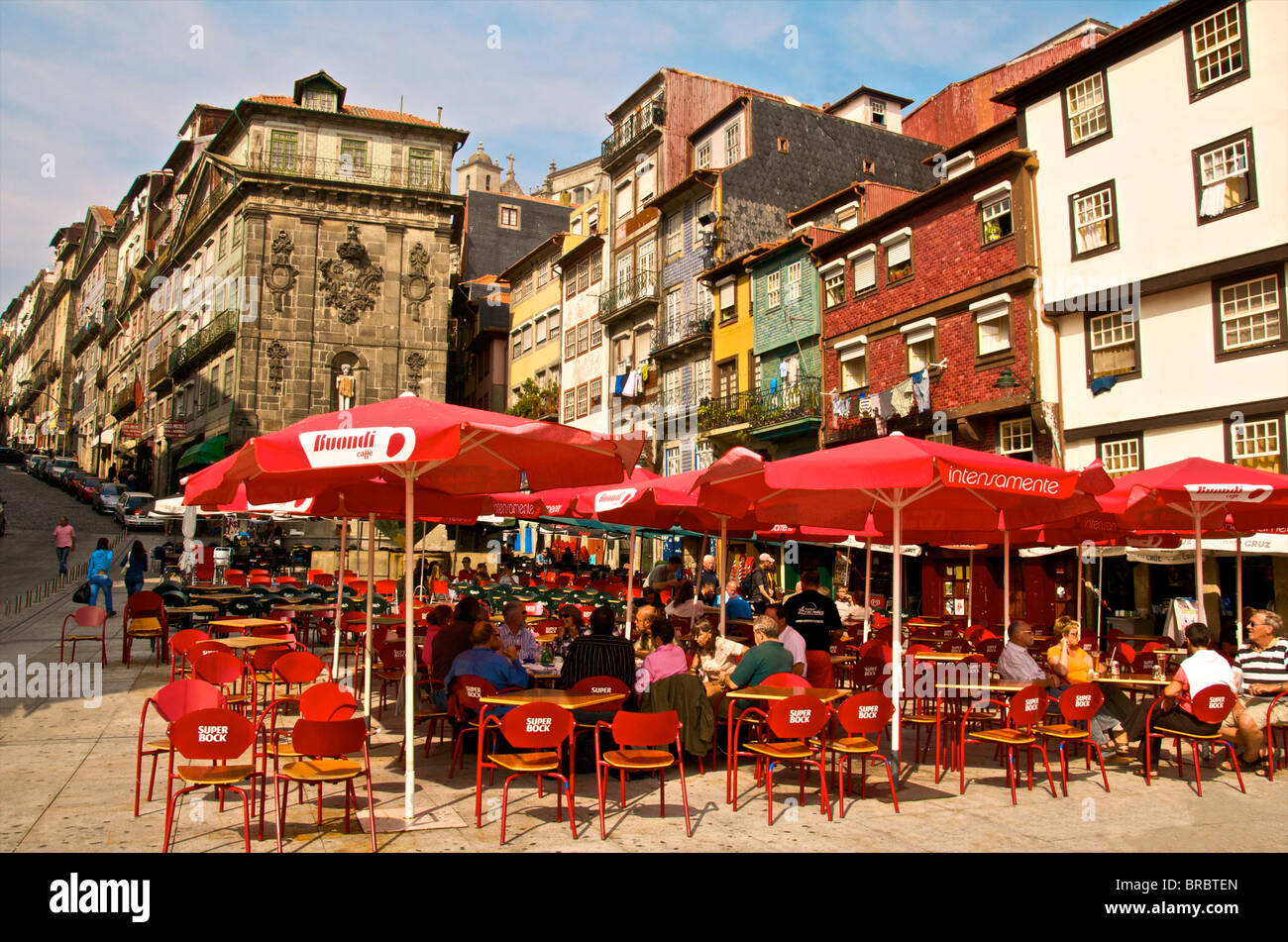 Red sunshades of cafes in Ribeira Square, Porto, Portugal - Stock Image