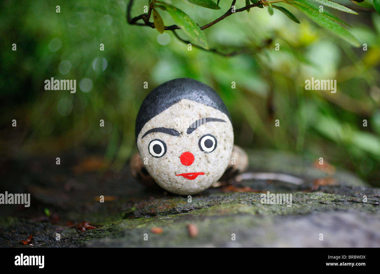 Painted stone used in shamanist rituals, Seoul, South Korea - Stock Image