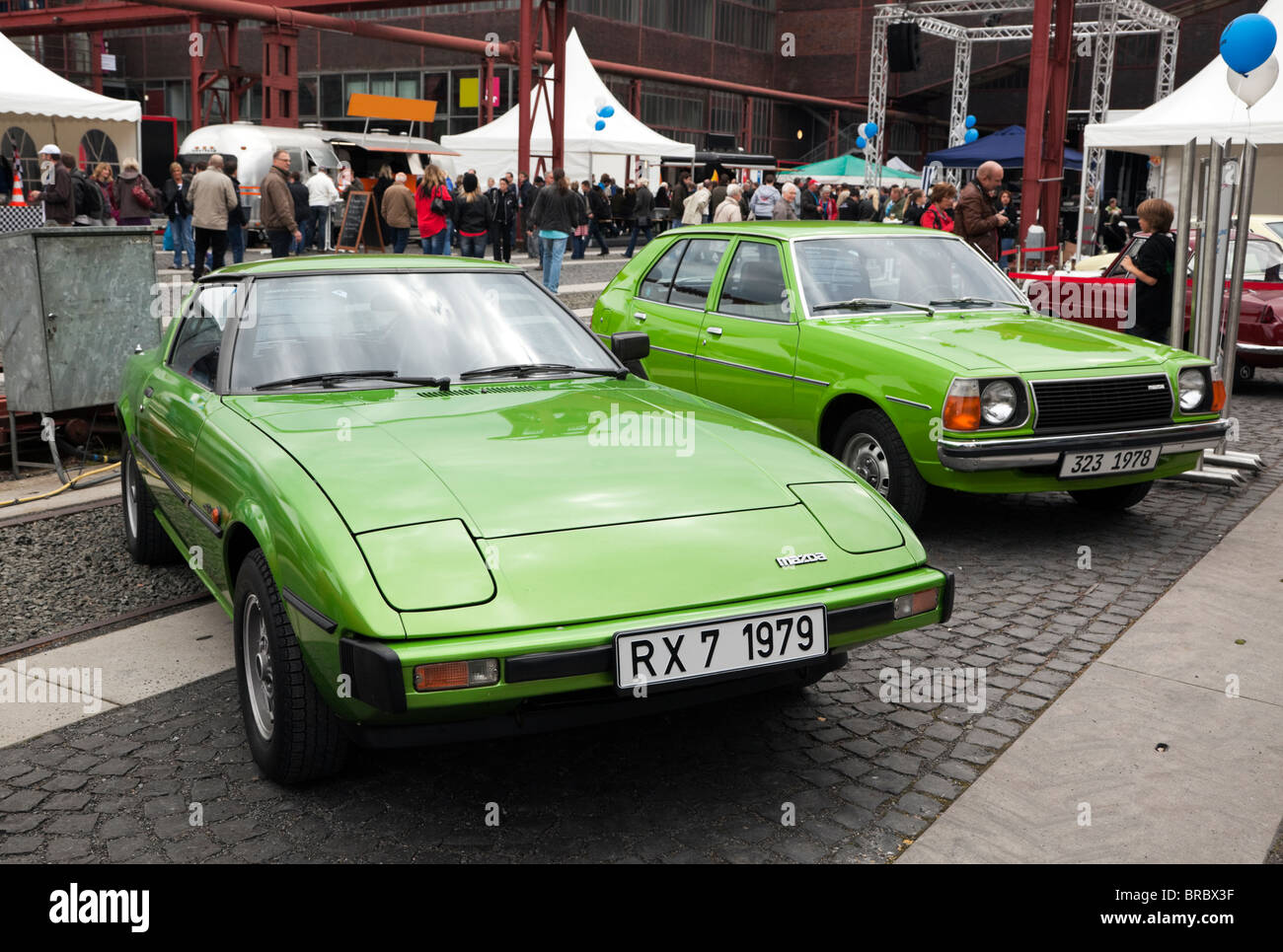 Green 1979 Mazda RX 7 And 1978 Mazda 323 Cars Displayed At The MX