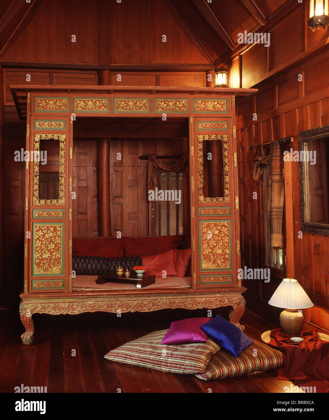 Interior of a Thai style home with a Thai-Chinese bed, Thailand - Stock Image