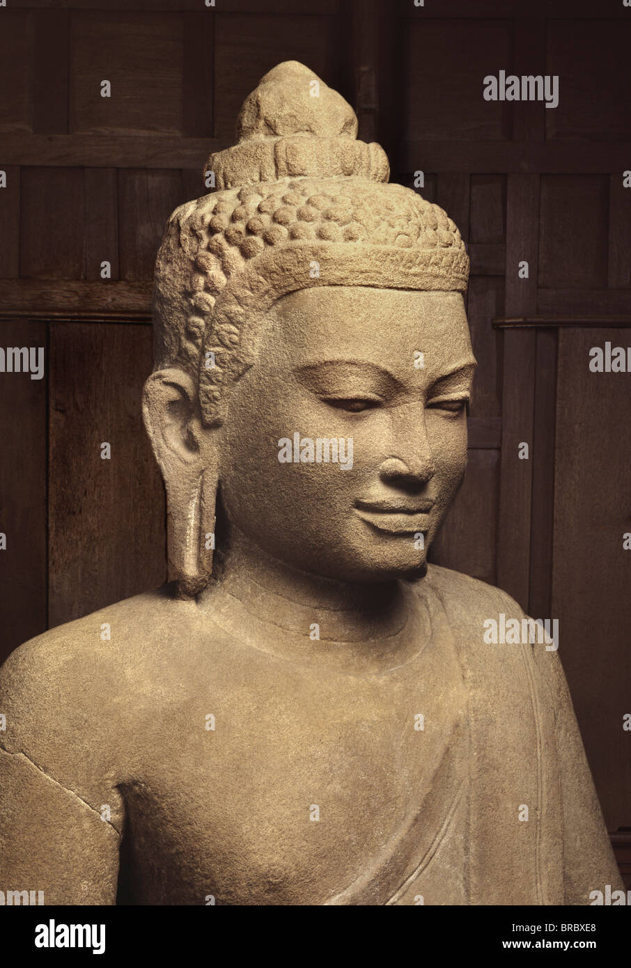 Head and torso of a sandstone Buddha, Lopburi style (Khmer influence) from the 14th century, Wat Mahathat, Lopburi, - Stock Image