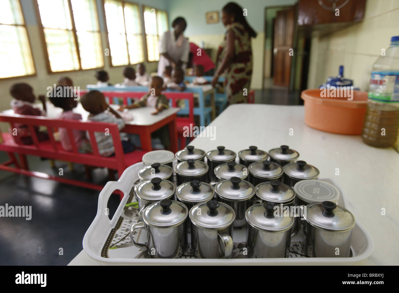 Meal time at a nursery and kindergarten run by Catholic nuns, Lome, Togo, West Africa - Stock Image