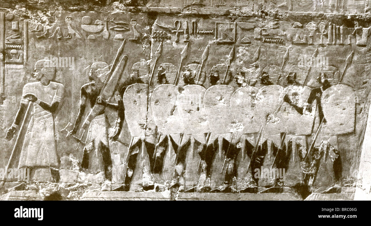 This bas-relief of spearmen in the Egyptian army adorned the mortuary temple of Hatshepsut, the 18th-Dynasty female - Stock Image