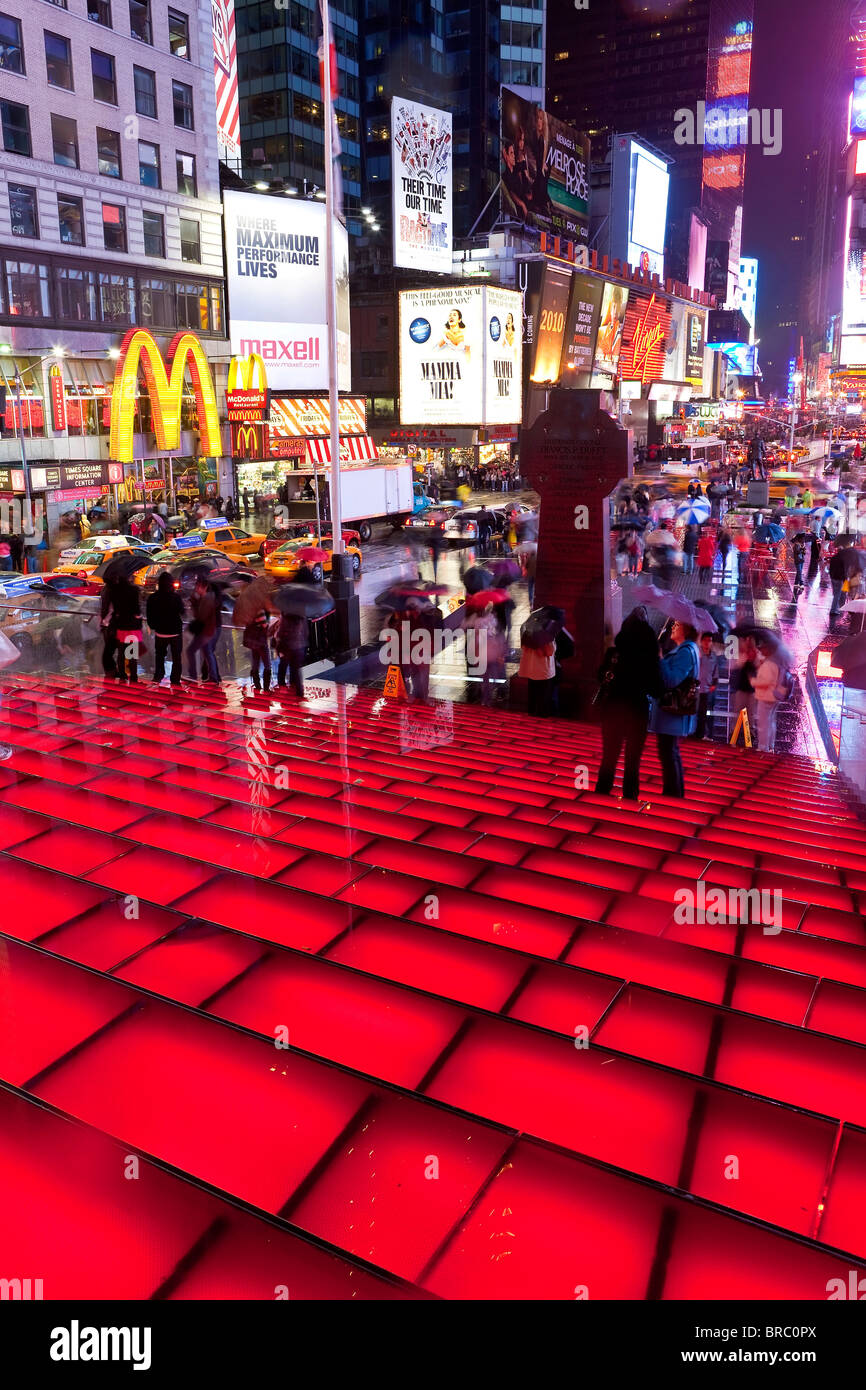 Neon lights on a rainy night, Times Square, Manhattan, New York City, New York, USA - Stock Image
