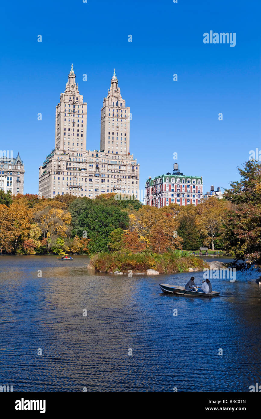 Central Park and the Grand buildings along Central Park West viewed across the lake in autumn, Manhattan,  New York, - Stock Image