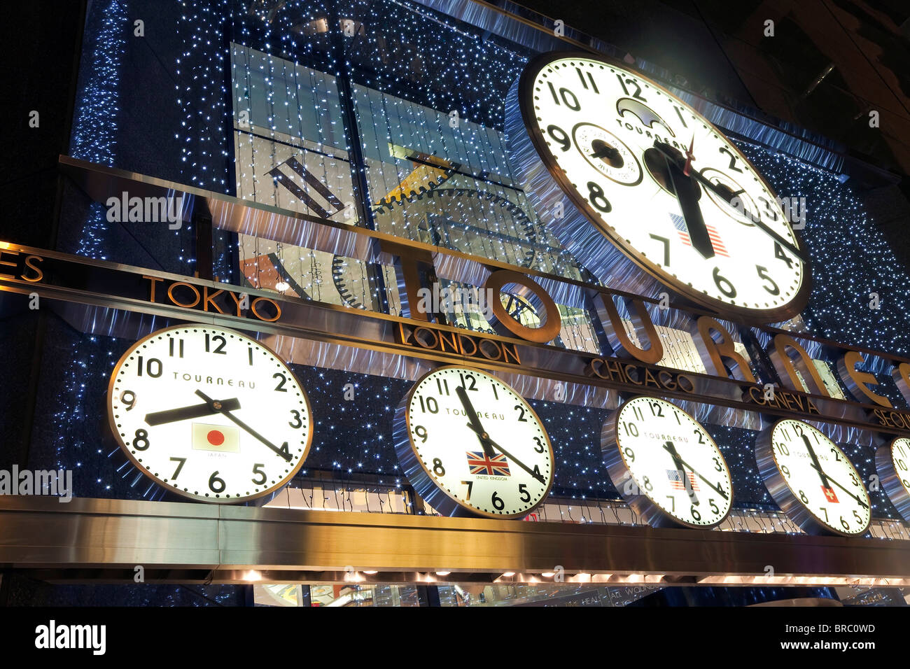Clocks showing various world city times outside the Tourneau Store, Manhattan, New York City, New York, USA - Stock Image