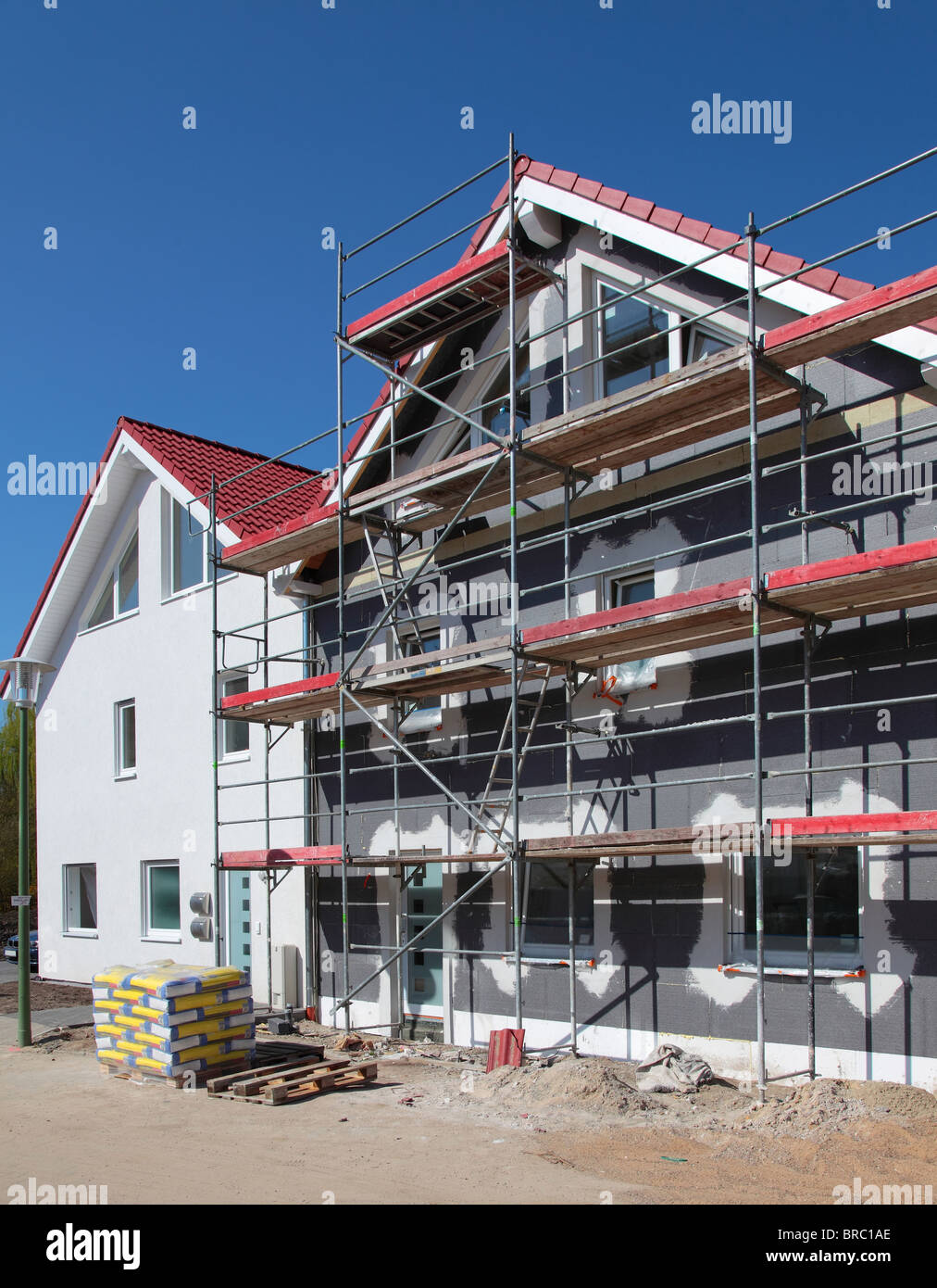 A new houses in shell construction on a shiny summery day. - Stock Image