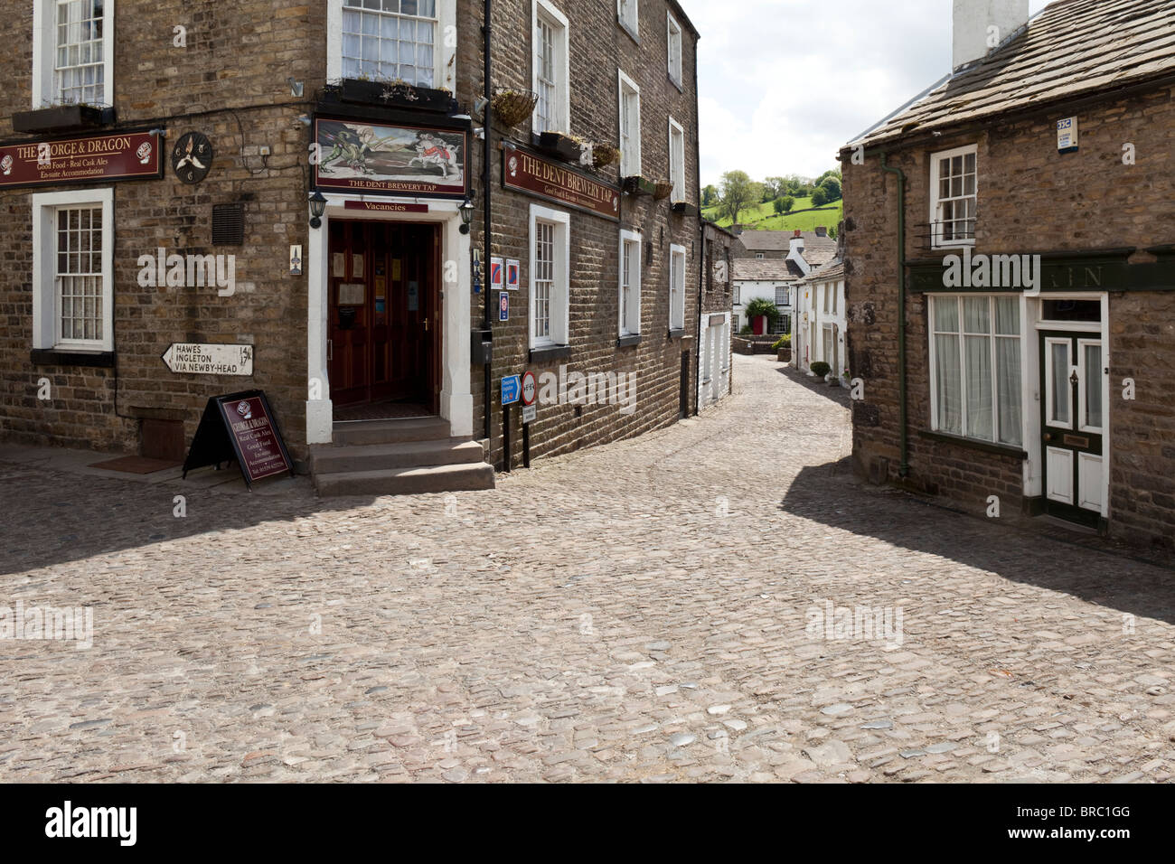 The cobbled Main Street of the Yorkshire Dales National Park village of Dent, Dentdale, Cumbria. - Stock Image