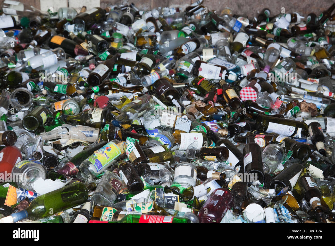 Europe. Pile of bottles and jars in glass recycling facility - Stock Image