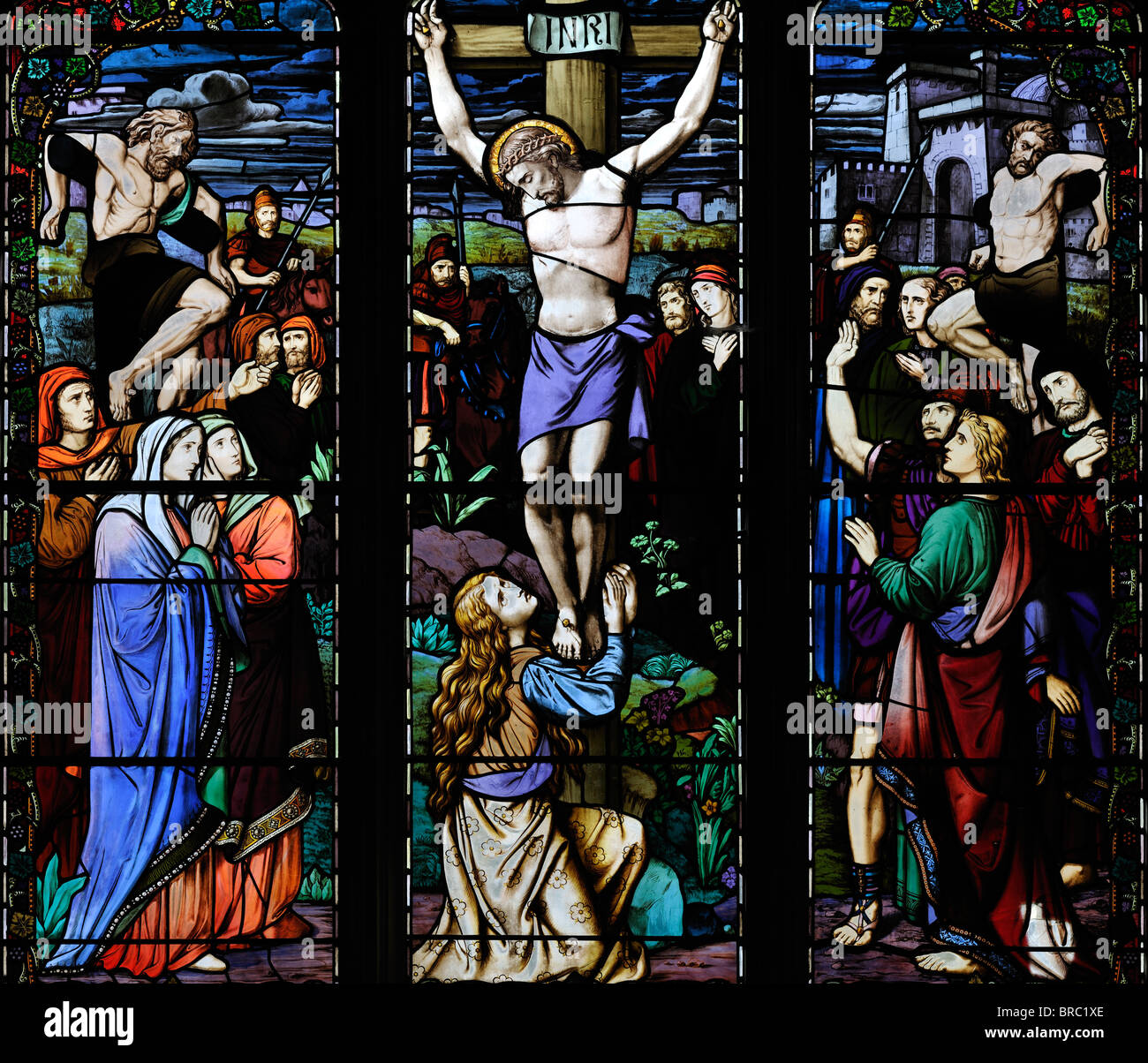 Vibrant Victorian window depicting the crucifixion of Jesus Christ - Stock Image