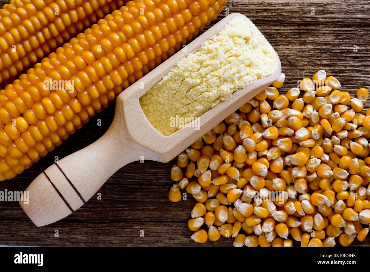 Corn on wooden desk - Stock Image