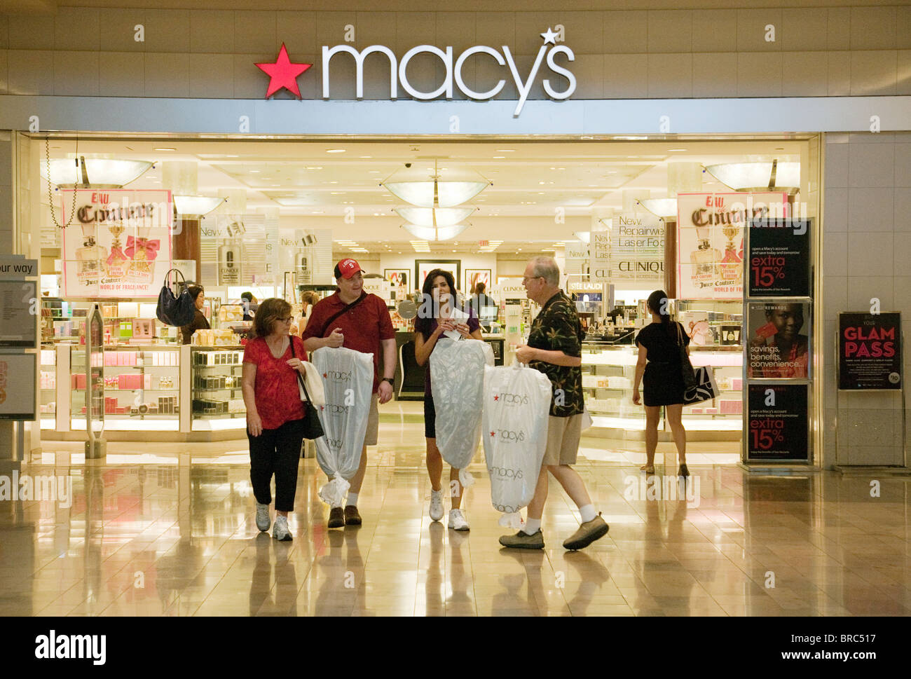 People coming out of Macys department store having bought goods, Fashion Show Mall, Las Vegas USA Stock Photo
