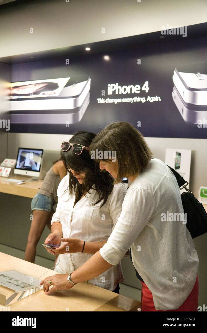 People trying out the iphone at the Apple Store, Fashion Show Mall, Las Vegas USA Stock Photo