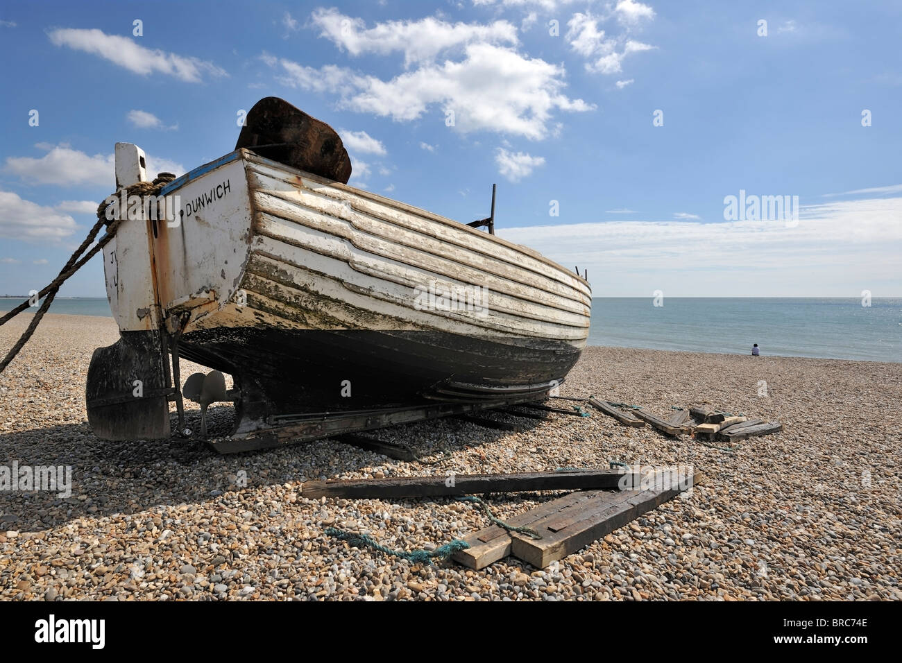 Beached fishing boat at Dunwich, Suffolk, England - Stock Image