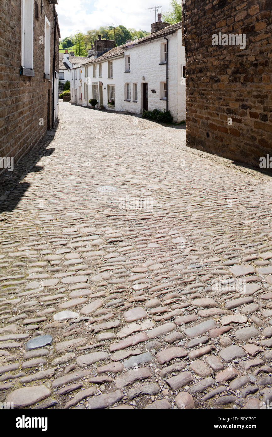 A cobbled lane in the centre of the Yorkshire Dales National Park village of Dent, Dentdale, Cumbria. - Stock Image