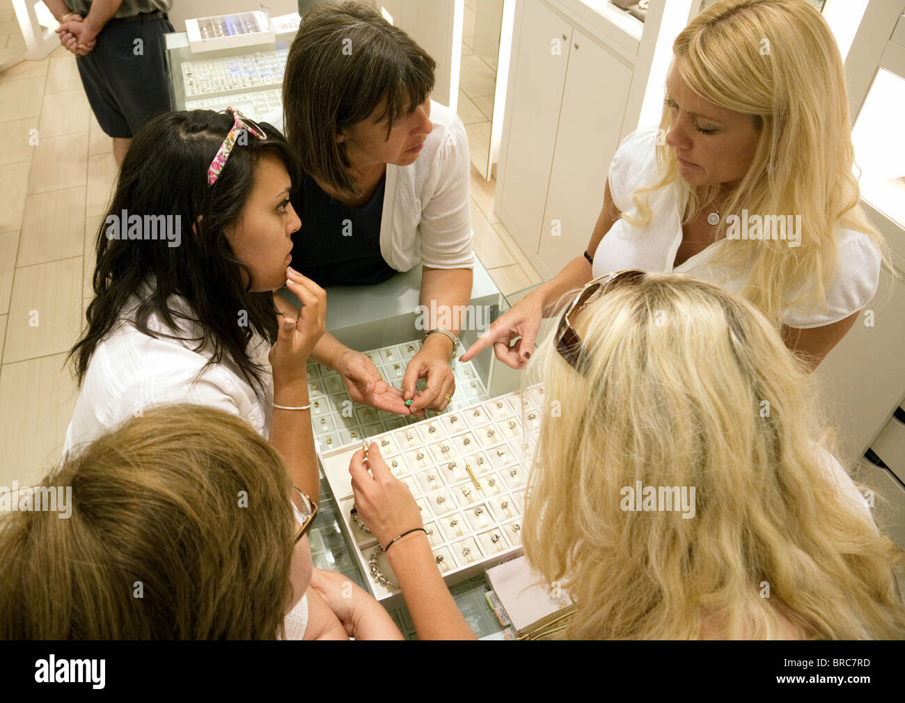 A jeweller helping a teenage girl buy jewellery in the Pandora store , the Forum shops, Caesars Palace Hotel, Las - Stock Image