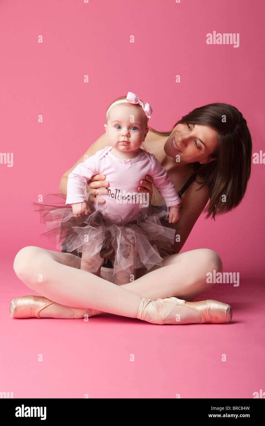 Baby Girl In Tutu With Ballerina In Pointe Shoes - Stock Image