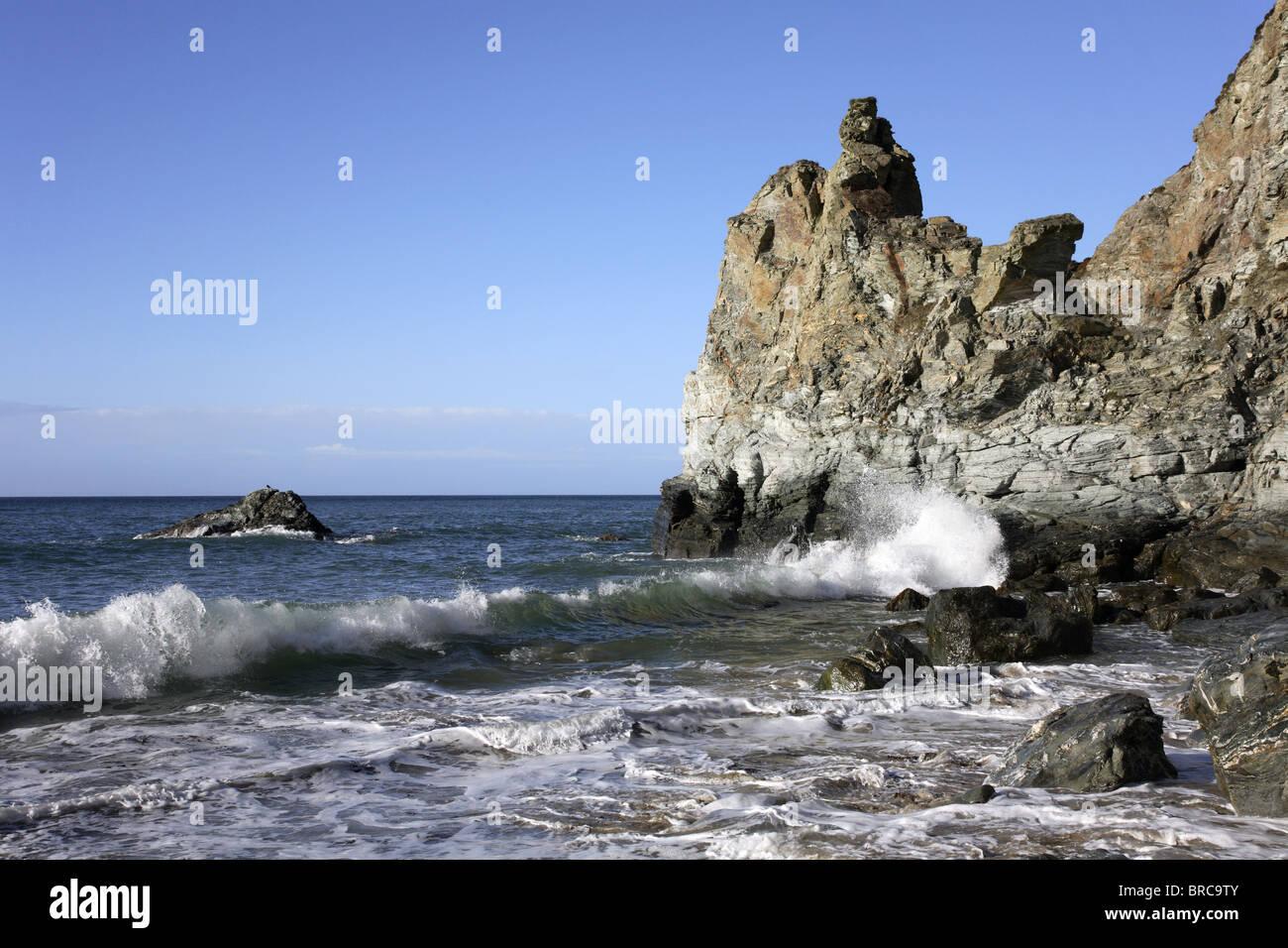 Waves crashing against rocks at St Agnes, Cornwall, UK. - Stock Image