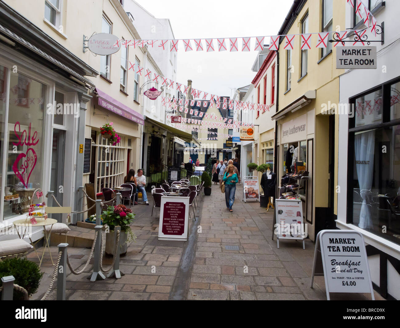 Typical small paved street in the centre of St. Helier, Jersey - Stock Image