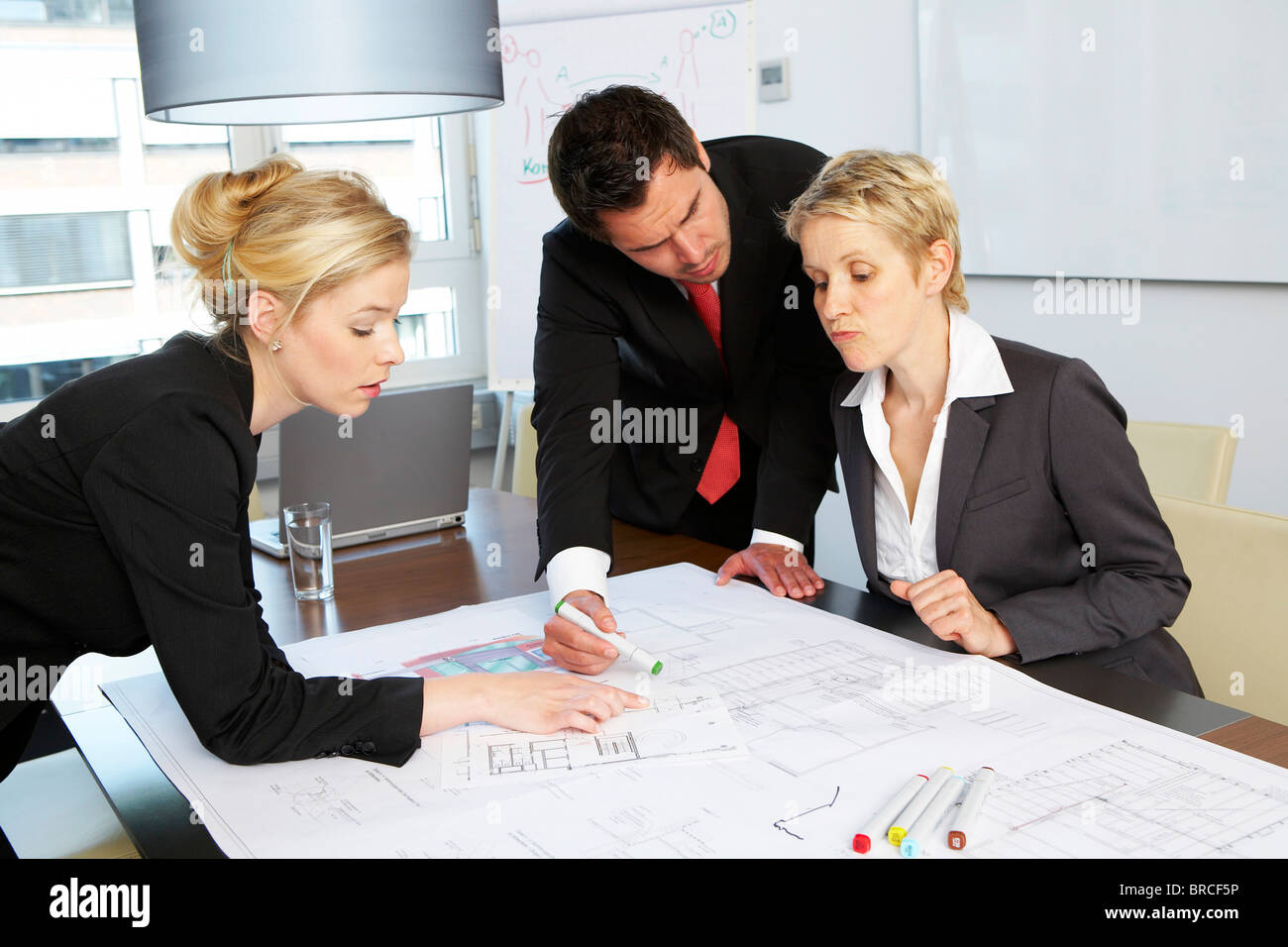 Three colleagues having a business conference - Stock Image