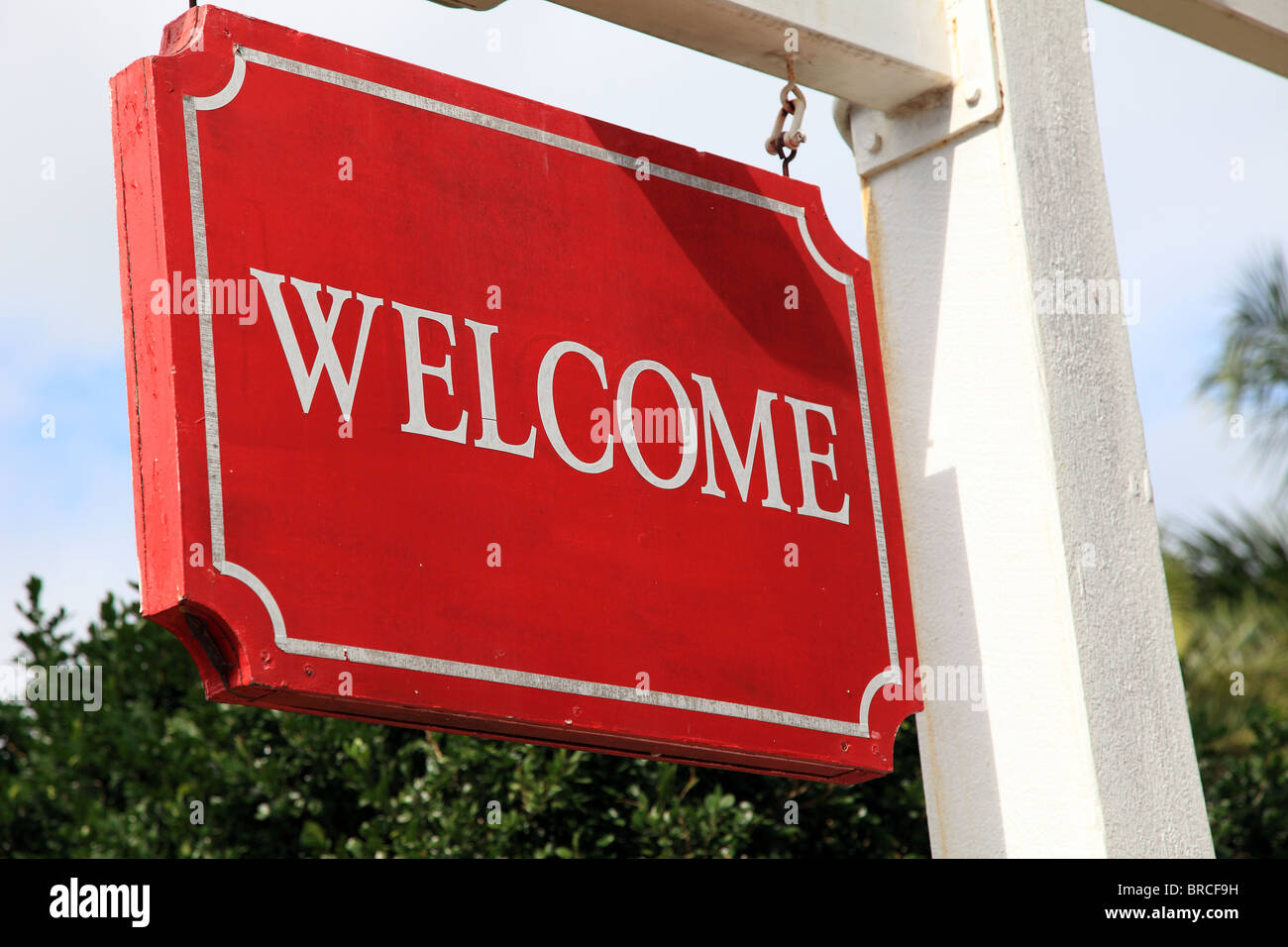 Red welcome sign of a hotel or restaurant. - Stock Image