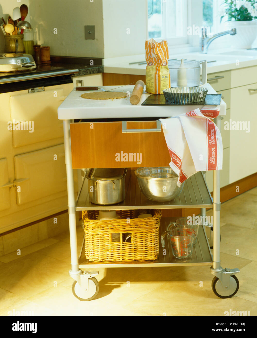 Close Up Of Cookery Ingredients On Modern Kitchen Trolley With Steel