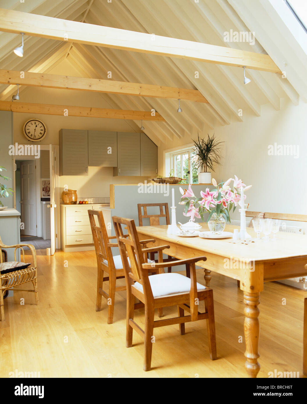 Wooden Chairs And Pine Table In Traditional Kitchen Small Barn Conversion With Beamed Apex Ceiling