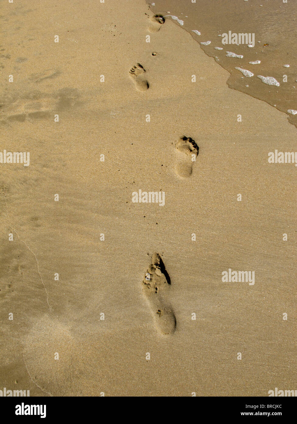 Footprints in the sand on the Ile de Re, France - Stock Image