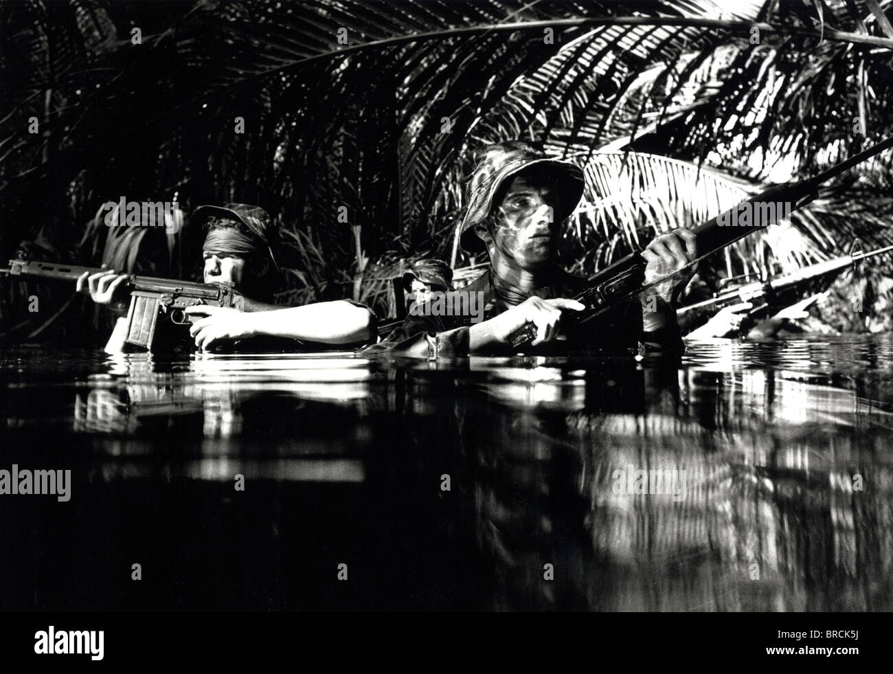 Black and white image of two soldiers hiding in water - Stock Image