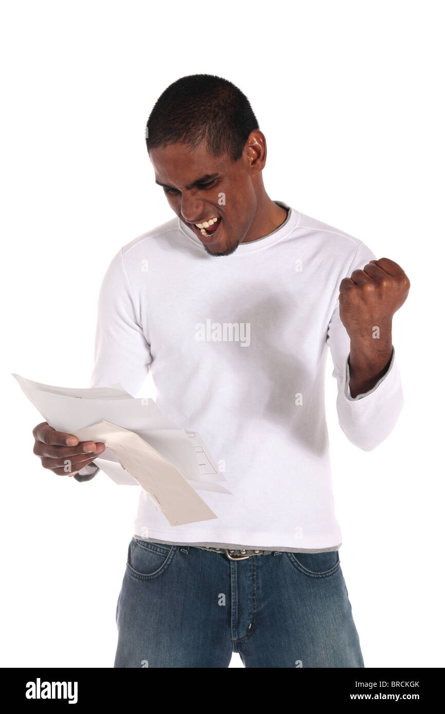 An attractive dark-skinned man getting good news via mail. All on white background. - Stock Image