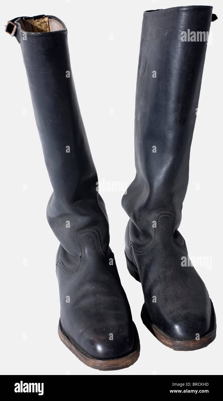 A pair of riding breeches and boots, for the black SS-Service uniform Black wool riding breeches, brown artificial - Stock Image
