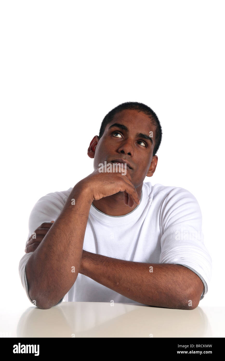 An attractive dark-skinned man deliberating a decision. All on white background. - Stock Image