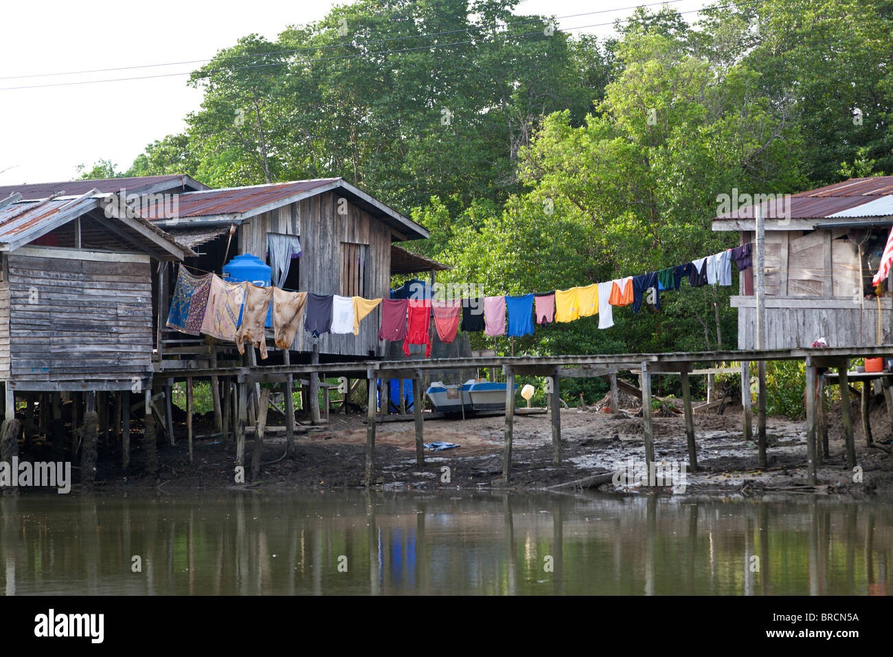 Washing hanging up outside a traditional riverside house, Sabah, Borneo Stock Photo