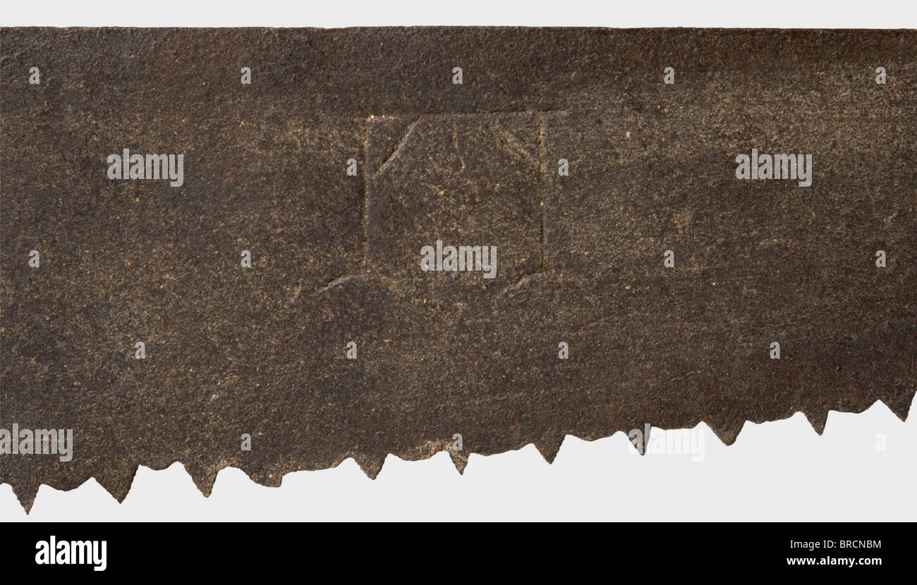 A German executioner's saw, dated 1594 Coarsely serrated saw blade, the front engraved with a wheel and gallows, - Stock Image