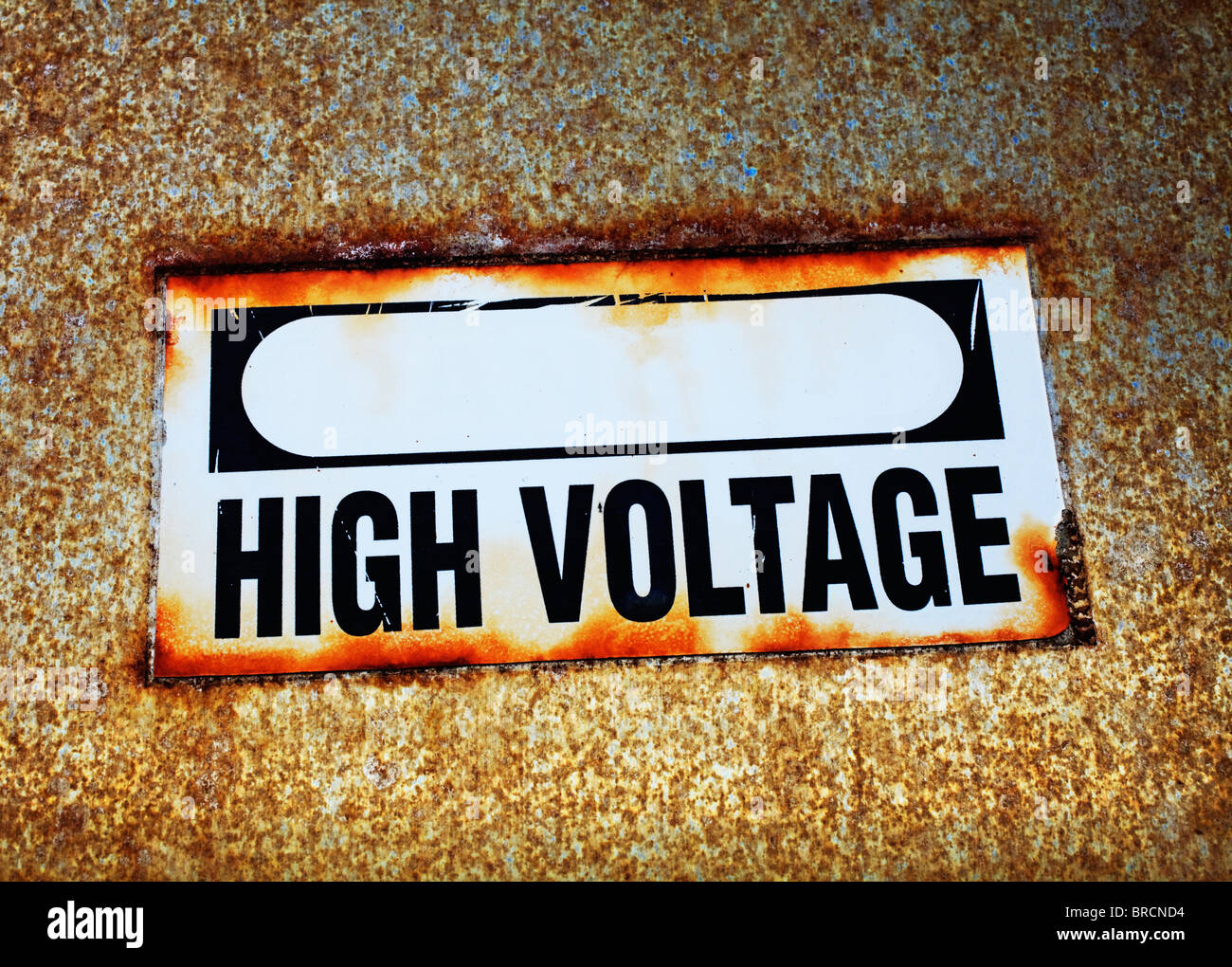 old and faded high voltage sign mounted onto power box - Stock Image