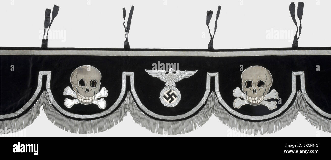 A kettledrum cloth, for an SS-Band Black velvet edged with silver lace terminating in a silver fringe. Five panels, - Stock Image