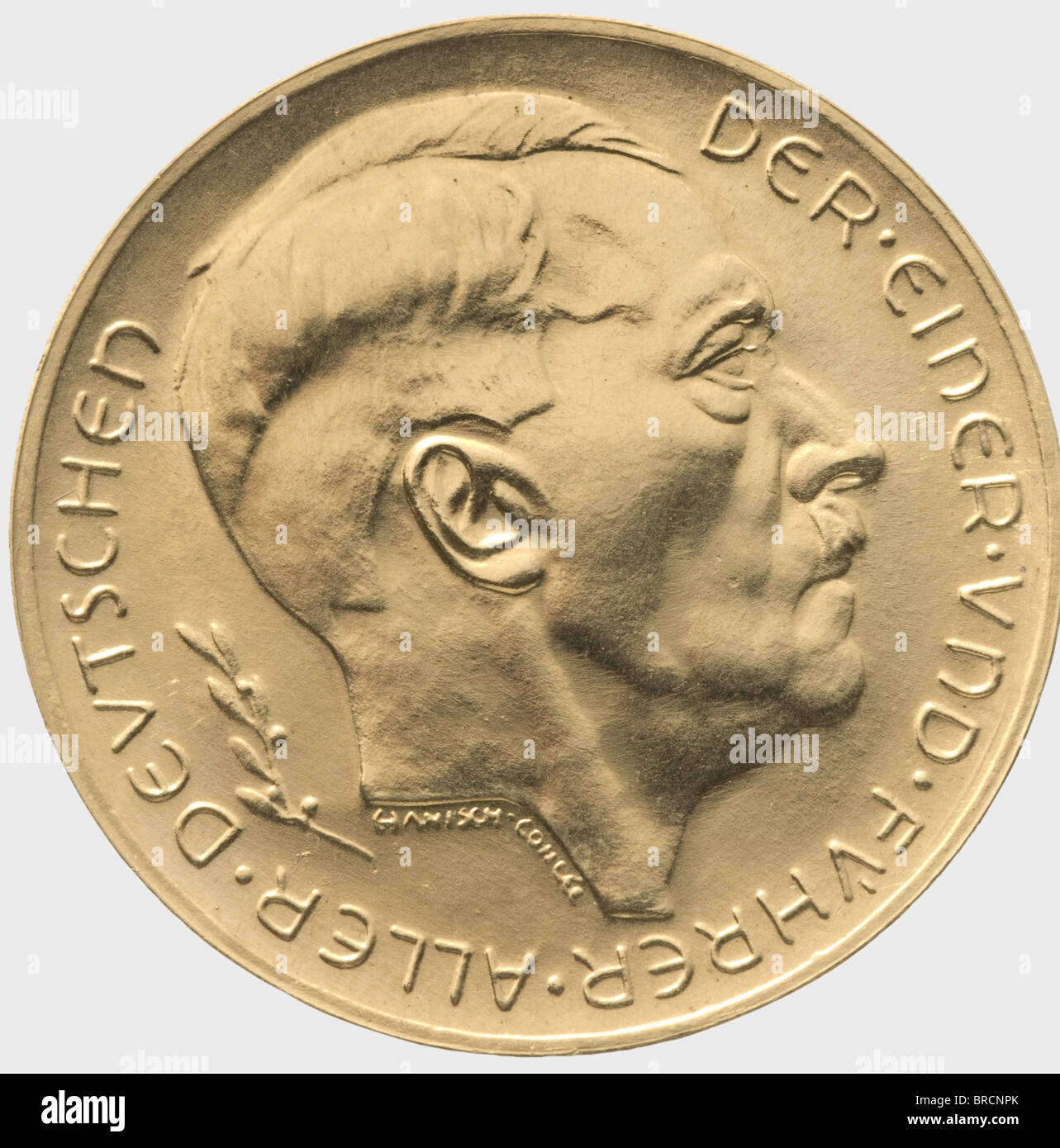 A gold medal, Das Großdeutsche Reich ist entstanden 1938 - 39 Gold. The front bears an orb surrounded by the - Stock Image
